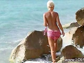 nude blond prettiness on a shore