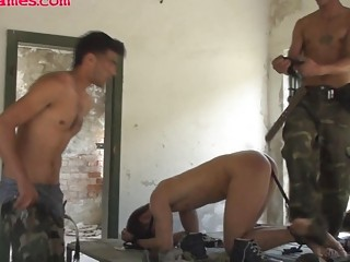 two military boys are scoffing at a male and