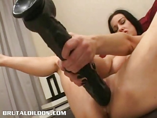 brunette cumming all over a giant brutal sex toy