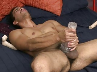 muscled gay hunk mastrubating inside the bedroom