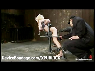 Gagged Madison Scott toyed restrained in metal