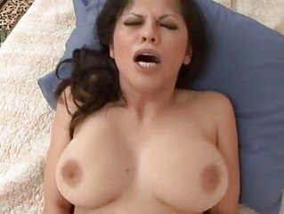 provocative curly brunette with big bazookas