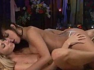 homosexual women kissing softly when laying into