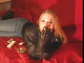 smoking 120mm chick into dark leather jacket and