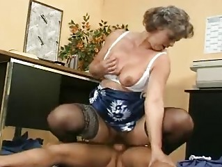 cougar demonstrates her chest and hirsute vagina