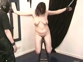 brunette bdsm young slave tied up by master