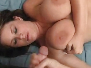 young lady with huge tits give a handjob