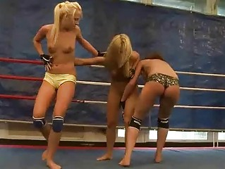Three sexy girls in wild lesbian wrestling