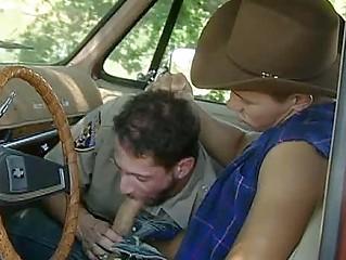 good cop giving head to a cowboy into a car